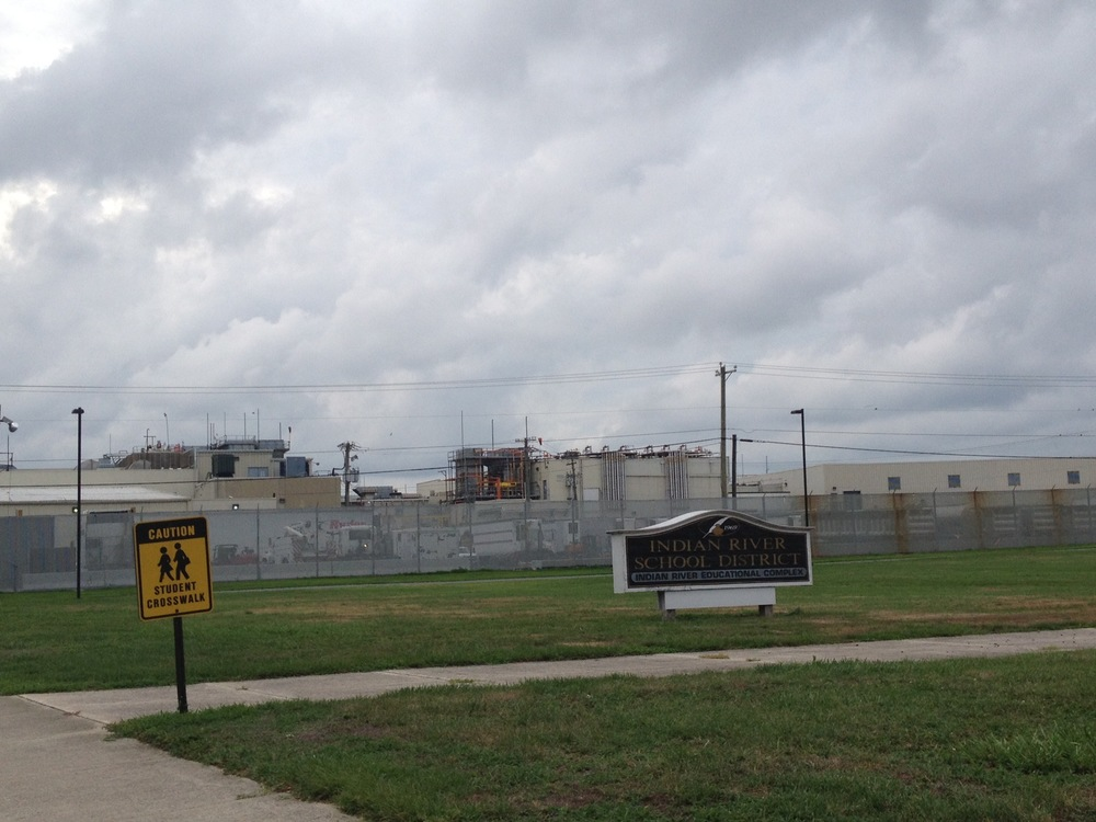 Mountaire's poultry plant separated only by a chain link fence from the Indian River School complex.